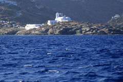 Church on Greek island coastline Stock Photo
