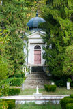 Church in green foliage Stock Images