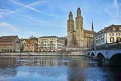 Church of Grossmunster and reflection in Limmat River, Zurich Royalty Free Stock Photo