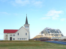 A Church of Grundarfjordur Town and the Famous Kirkjufell Mountain, Iceland. Amazing View stock photo
