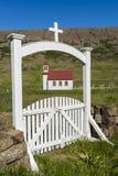 Church at Gufudalur-Nedri with Gate in Iceland. White church with red roof and white gate at Gufudalur-Nedri on Iceland Stock Photos