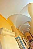 Church hall. Example of one of long corridors inside monastery Stock Photos