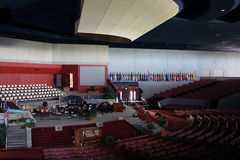 Church Hall. Interior of auditorium style church hall.  Seating is organized in a half-shell arched fashion with stage in front Stock Images