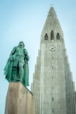 The church of Hallgrímur with the statue of Leifur Eiriksson. REYKJAVIK, ICELAND - APRIL 7 - 2016: The church of Hallgrímur with the statue of Leifur stock image