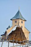Church and hay in Romania Stock Photos