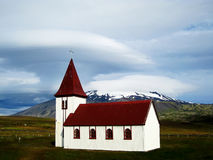 Church in Hellnar with Snaefellsjokull (Iceland). Typical red-roofed white little church in Hellnar (Iceland). Behind it can be seen the Snaefellsjokull volcano Stock Images