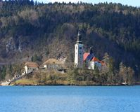 Church with a high Bell Tower on the island on Lake Bled in Slov Royalty Free Stock Images