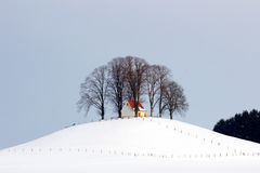 Church on a hill. Protected by trees on the hill stands a church Stock Photography