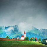 Church on the hill in the Alps Stock Image