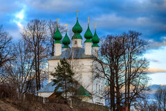 Church on a hill. On a background of dark blue clouds Stock Photo