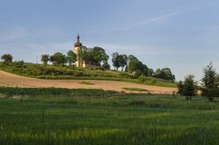 Church on hill. And green glade royalty free stock images