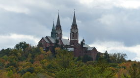Church on Hill. This magnificent church is on top a hill of colorful Autumn trees Royalty Free Stock Images