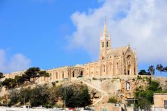 Church on the hill, Mgarr. View of Our Lady of Lourdes church on the hillside, Mgarr, Gozo, Malta, Europe Royalty Free Stock Image