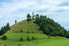 Church on the hill top. St Jakob church on the hill top in Slovenia royalty free stock photo