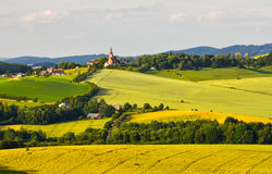 Church on the hill. View of the valley ripening grain and the church on the hill Stock Photo