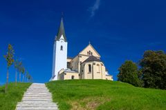 Church on a hill in the village Ragosalovaci, Slovenia Stock Images