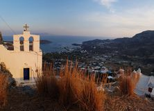 Church on hilltop in Sifnos. An Orthodox church on a hilltop in Sifnos with a panoramic view of the island at dusk Stock Image