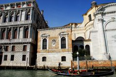 Church and historic palazzo on the Grand Canal in Venice in Italy Royalty Free Stock Photos