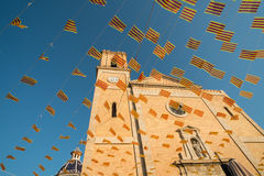 Church and holiday flags Royalty Free Stock Image