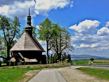 The church of Holy Cross in Chabówka in Poland. Beautiful, old, wooden roman catholic church located  near the Zakopianka road. It was built in eighteen Royalty Free Stock Image