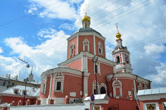 The church of the Holy Apostles Peter and Paul by the Yauza Gate under cloudy sky, Moscow, Russia. 1700 year built. Church of the Holy Apostles Peter and Paul by Stock Photo