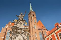 Church of the Holy Cross and St Bartholomew and statue of John of Nepomuk in Wroclaw, Poland. stock photos