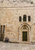 Church of the Holy Sepulchre. Old couple sitting outside the Church of the Holy Sepulchre stock photo