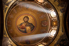 Church of the Holy Sepulchre. A mosaic icon of Jesus adorns the domed ceiling of Jerusalem's Church of the Holy Sepulchre, traditional site of Christ's stock image