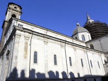 Church of holy shroud. This church - Duomo G. Battista is home to the famous shroud of Turin. Shadows at the bottom of the building are cast by chimneys on the royalty free stock photo