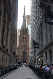 Church of the Holy Trinity between skyscrapers. Photo of: Wall street New York Stock Exchange and Church of the Holy Trinity between skyscrapers Stock Image