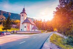 Church of the Holy Virgin Mary in Ribchev Laz village. Bohinj Lake, Triglav national park Slovenia, Julian Alps, Europe. Lomography stylization and instagram Stock Image