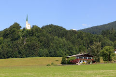 Church and house in the alps Stock Photo
