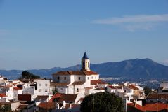 Church and houses, Yunquera, Spain. Incarnation Church (built in 1505) and townhouses, whitewashed village (pueblo blanco), Yunquera, Malaga Province, Andalusia Stock Photos