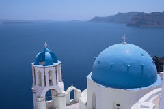 Church at Ia (horizontal). One of the famous churches at Ia (or Oia) on the Greek island of Santorini. In the background is the caldera with the island of royalty free stock photo