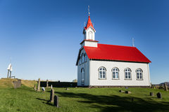 Church in Iceland. White church with a red roof in Iceland Stock Photo