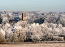 Church in the icy white Winter trees. Refuge or safety.