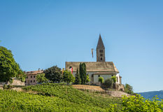 The Church of the idyllic village of Cortaccia. Cortaccia extends on the sunny side of the wine road. South Tyrol, Italy. Royalty Free Stock Photos
