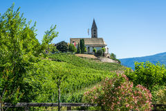 The Church of the idyllic village of Cortaccia. Cortaccia extends on the sunny side of the wine road. South Tyrol, Italy. Royalty Free Stock Photography