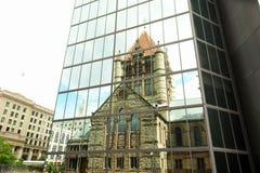 Church illusion. Boston's trinity church is reflected in the claen windows of a nearby skyscraper Stock Photo
