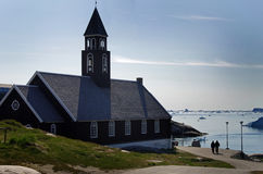 Church, Ilulissat, Greenland. A church in Ilulissat, Greenland during the midnight sun period with a view to Disko Bay Stock Photos