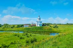 The temples of Suzdal. The church of Ilya the Prophet located on the green expanses of Ilinskiy meadow on the bank of Kamenka river, Suzdal, Russia Stock Photography