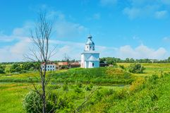 The old Suzdal. The church of Ilya the Prophet topped the tiny hill in the middle of Ilinskiy meadow at the bend of Kamenka river, Suzdal, Russia Stock Images