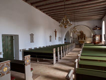 Church Inside. View over danish church inside with white walls and green benches Royalty Free Stock Images