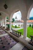 Church inside Sambata de Sus Monastery seen trough a colonade in Stock Images