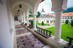 Church inside Sambata de Sus Monastery seen trough a colonade in Royalty Free Stock Photo