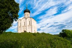 Church of the Intercession of the Holy Virgin on the Nerl River on the bright summer day. Ancient city Vladimir with suburbs is recognized as significant Royalty Free Stock Photography
