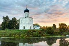 Church of Intercession of Holy Virgin on the Nerl River at dawn. Royalty Free Stock Image