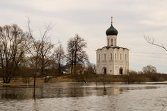 The Church of the Intercession of the Holy Virgin on the Nerl River. Spring landscape. Church of the Intercession on the River Nerl is an Orthodox church and a Stock Photo