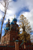 Church of the Intercession of the Holy Virgin. Stone church in the village among the trees in the autumn Royalty Free Stock Photo