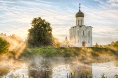 Church of the Intercession on the Nerl in Bogolubovo. Church of the Intercession on the Nerl with glowing morning fog in Bogolubovo, Vladimir oblast, Russia Royalty Free Stock Photos